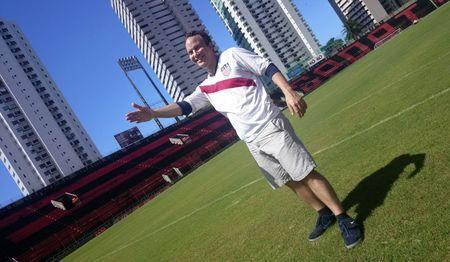 Steve Lange poses for a picture on the pitch of the Estadio Ilha do Recife in Recife June 27, 2014. REUTERS/Philip O'Connor