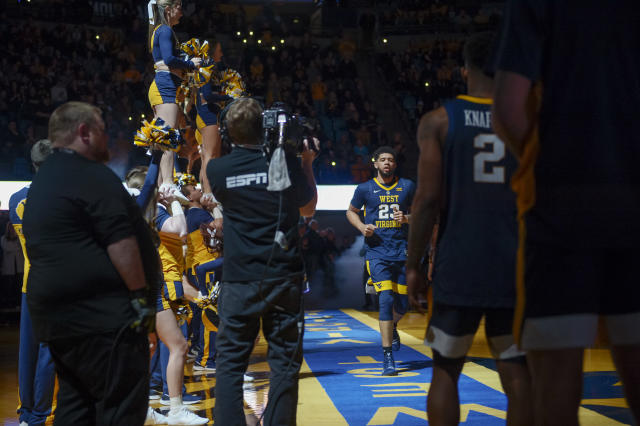 West Virginia Mountaineers forward Esa Ahmad (23) joins his teammates on the court during team introductions before an NCAA college basketball game against the University of Texas Longhorns in Morgantown, W.Va. on Saturday Feb. 9, 2019. (AP Photo/Craig Hudson)