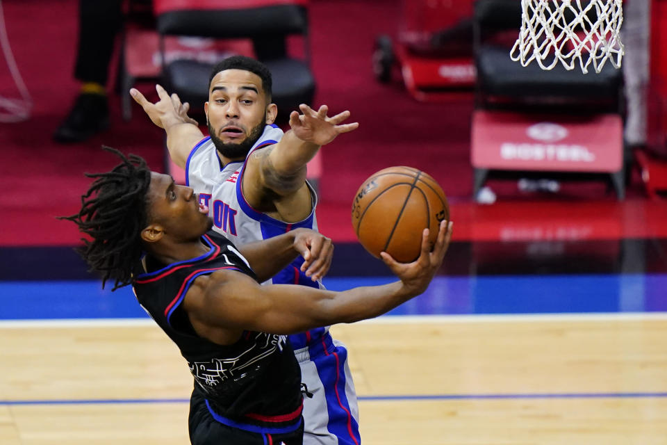 Philadelphia 76ers' Tyrese Maxey, left, goes up for a shot against Detroit Pistons' Cory Joseph during the second half of an NBA basketball game, Saturday, May 8, 2021, in Philadelphia. (AP Photo/Matt Slocum)