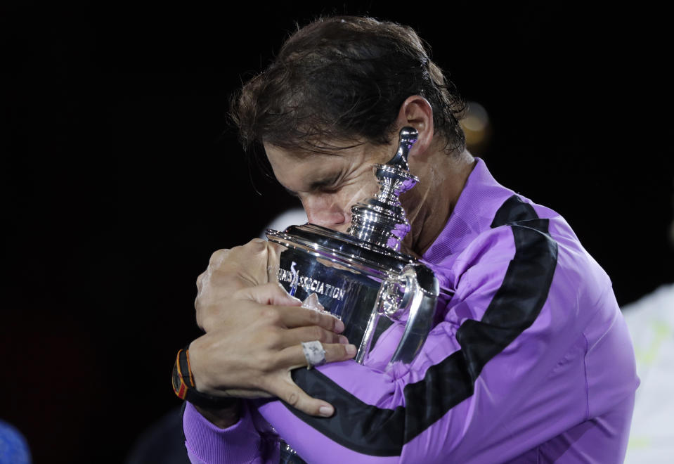Rafael Nadal, of Spain, hugs the trophy after defeating Daniil Medvedev, of Russia, to win the men's singles final of the U.S. Open tennis championships Sunday, Sept. 8, 2019, in New York. (AP Photo/Adam Hunger)