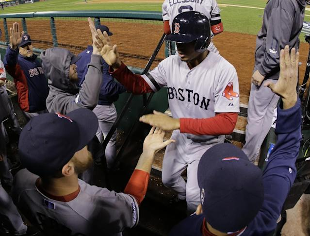 Boston Red Sox shortstop Xander Bogaerts is congratulated by teammates after scoring on a David Ross RBI ground rule double to left field against the St. Louis Cardinals during the seventh inning of Game 5 of baseball's World Series Monday, Oct. 28, 2013, in St. Louis. (AP Photo/Matt Slocum) (AP Photo/Matt Slocum)