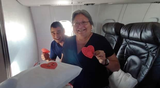 Yukoners Derek Yap and Sharon Shorty, seen here renewing their wedding vows on a flight last year, had been planning their trip to the Tokyo Games since 2019. (Submitted by Sharon Shorty - image credit)