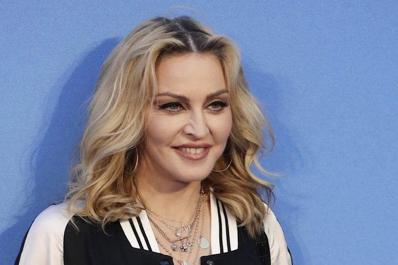 Hitting out: Madonna takes aim at Guy Ritchie on Father's Day: AP Photo/Kirsty Wigglesworth