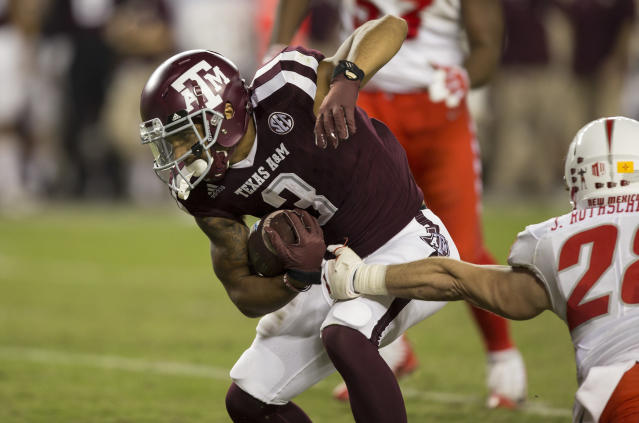 "Texas A&M wide receiver <a class=""link rapid-noclick-resp"" href=""/ncaaf/players/251078/"" data-ylk=""slk:Christian Kirk"">Christian Kirk</a> (3) shakes off a tackle-attempt on Saturday, Nov. 11, 2017, in College Station, Texas. (AP Photo/Sam Craft)"