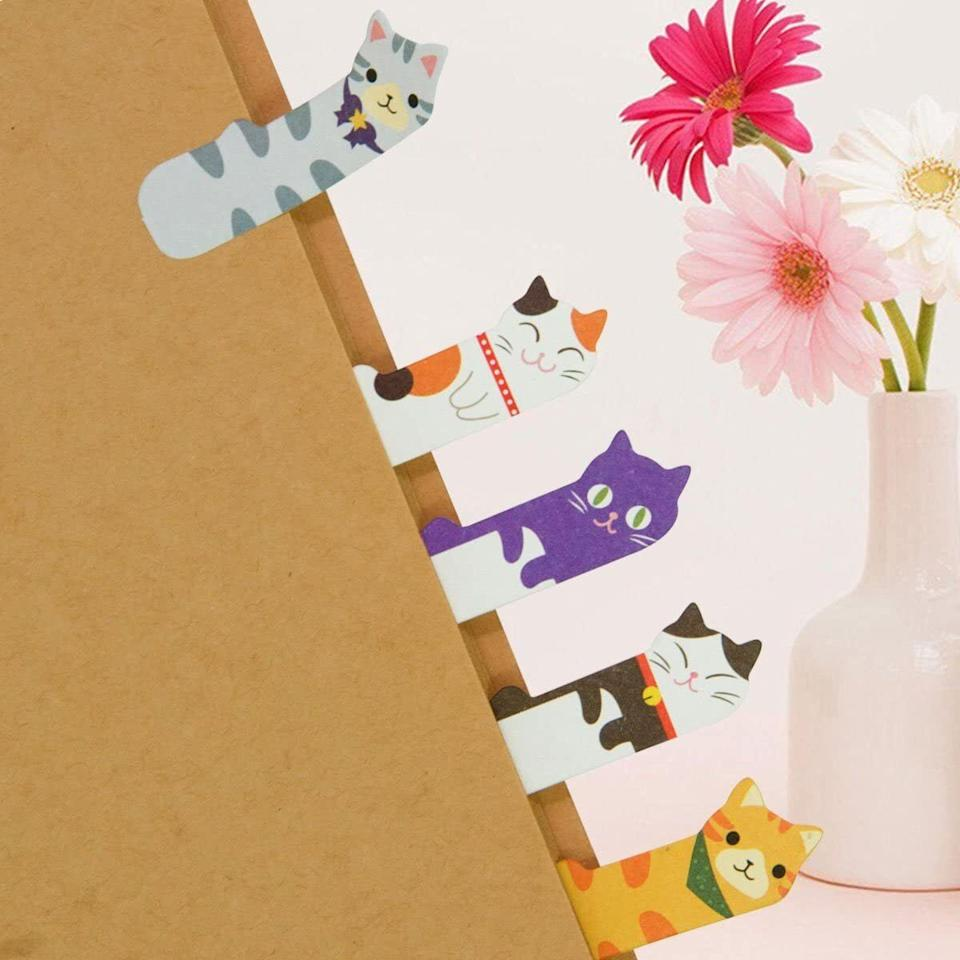 """Use them as bookmarks or tiny reminders so you can remember where you stopped reading or the date of your next doctor's appointment!<br /><br /><strong>Promising review:</strong>""""These cute sticky notes are not just for kids; any cat lover would love them. <strong>It makes me smile when I see the cute cat marking my place without destroying the book.</strong> Thank you for these cute cats. They bring smiles to others when I use them as gifts as well."""" —<a href=""""https://amzn.to/3eWXaJX"""" target=""""_blank"""" rel=""""nofollow noopener noreferrer"""" data-skimlinks-tracking=""""5851345"""" data-vars-affiliate=""""Amazon"""" data-vars-href=""""https://www.amazon.com/gp/customer-reviews/R1I2HBMY4E6ADQ?tag=bfnusrat-20&ascsubtag=5851345%2C2%2C34%2Cmobile_web%2C0%2C0%2C16315207"""" data-vars-keywords=""""cleaning,fast fashion"""" data-vars-link-id=""""16315207"""" data-vars-price="""""""" data-vars-product-id=""""15931572"""" data-vars-retailers=""""Amazon"""">Anonymous<br /><br /></a><strong><a href=""""https://amzn.to/3u1RbYu"""" target=""""_blank"""" rel=""""noopener noreferrer"""">Get them from Amazon for$7.99.</a></strong>"""