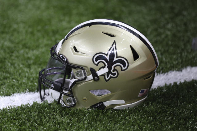 A New Orleans Saints helmet rests on the field during an NFL game against the Houston Texans, Monday, Sept. 9, 2019, in New Orleans. The Saints defeated the Texans 30-28. (Margaret Bowles via AP)