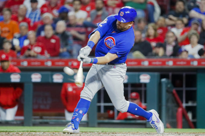 FILE - In this May 15, 2019, file photo, Chicago Cubs' Kyle Schwarber hits a solo home run off Cincinnati Reds relief pitcher David Hernandez in the eighth inning of a baseball game in Cincinnati. Schwarber agreed in principle to a one-year, $10 million contract with the Washington Nationals, according to a person familiar with the deal. The person confirmed the agreement to The Associated Press on condition of anonymity on Saturday, Jan. 9, 2021, because a physical exam was still pending for Schwarber. (AP Photo/John Minchillo, File)