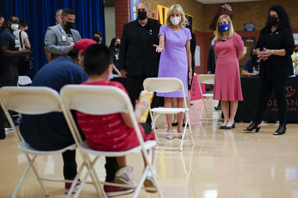First lady Jill Biden, Phoenix Mayor Kate Gallego, and Ray Arvizu, of Equality Health Foundation, tour a COVID-19 vaccination site at Isaac Middle School in Phoenix, Wednesday, June 30, 2021. (AP Photo/Carolyn Kaster, Pool)