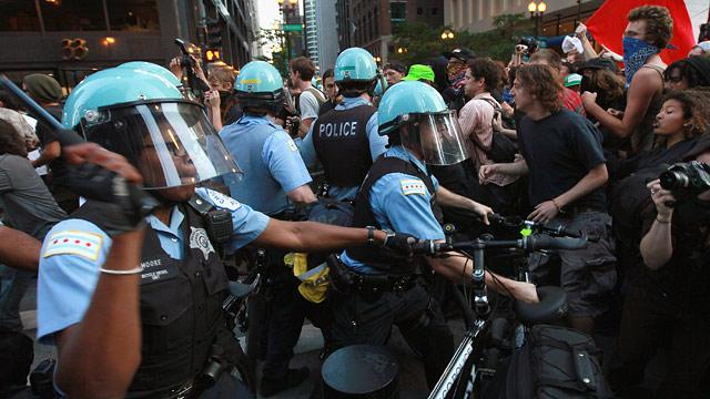 NATO Summit Protest: Anarchists Clash With Cops; Vets Return Medals
