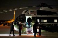 FILE PHOTO: U.S. President Donald Trump boards Marine One at Joint Base Andrews in Maryland to return to the White House