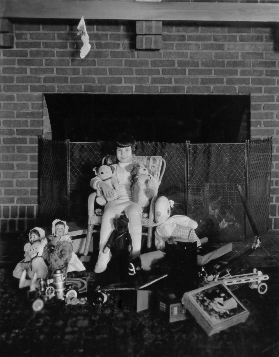 American child actress Baby Peggy, later known as Diana Serra Cary, surrounded by toys at Christmas, circa 1923. (Photo by Archive Photos/Getty Images)