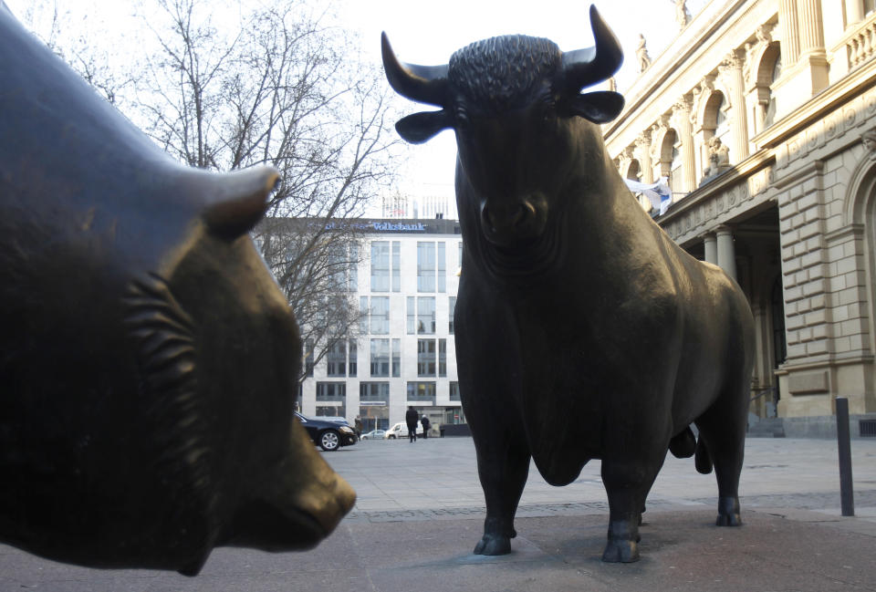 Bull and bear statues are pictured outside Frankfurt's stock exchange February 1, 2012.