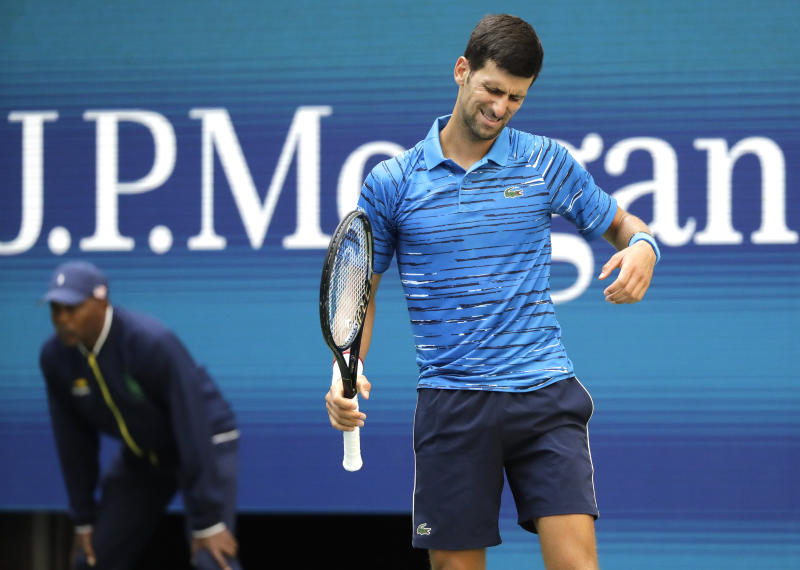 Novak Djokovic, of Serbia, reacts after a shot to Roberto Carballes Baena, of Spain, during the first round of the US Open tennis tournament Monday, Aug. 26, 2019, in New York. (AP Photo/Frank Franklin II)