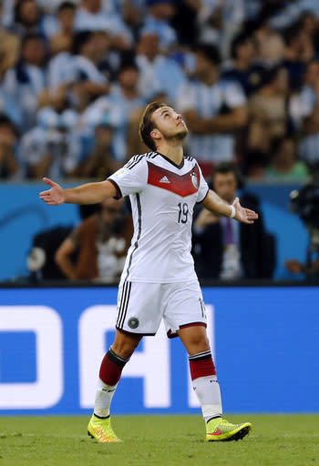 Germany's Mario Goetze celebrates after scoring the opening goal during the World Cup final soccer match between Germany and Argentina at the Maracana Stadium in Rio de Janeiro, Brazil, Sunday, July 13, 2014. Germany beat Argentina 1-0 to win the World Cup. (AP Photo/Frank Augstein)