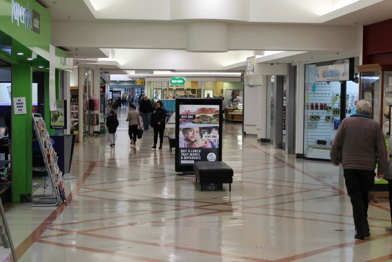 Shoppers are seen at a mall in Wellington, New Zealand