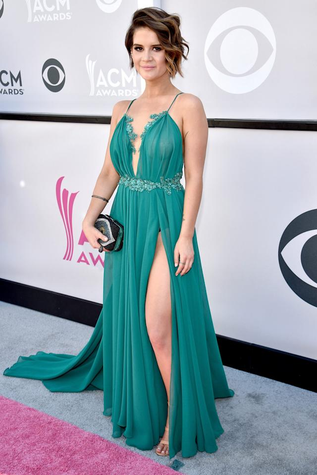 "<p>This songtress, who shares the lead for <a href=""https://people.com/country/acms-2020-nominations-thomas-rhett-maren-morris-dan-shay-lead-keith-urban-host/"">most nominations</a> (a whopping five!) with Thomas Rhett and producer Dann Huff), wore a gorgeous green goddess gown to the 2017 carpet.</p>"