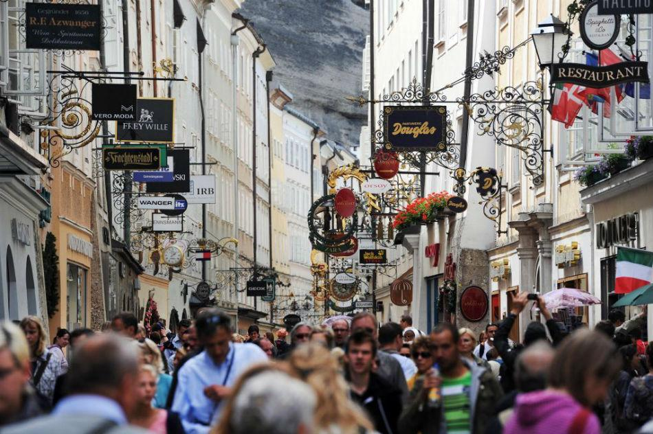 Crowds of people are seen at the Getreidegasse in the historic district of Salzburg, Austria.
