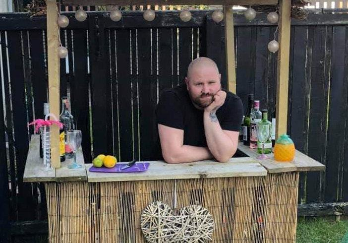 A man built a Tiki bar in his garden to help him survive the boredom of lockdown. (SWNS)