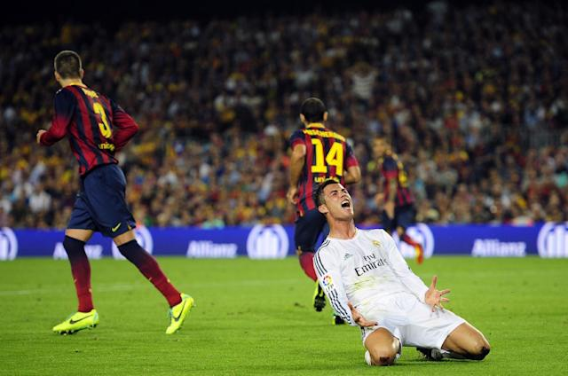 Real Madrid's Cristiano Ronaldo from Portugal reacts to a decision from the referee during the Spanish La Liga soccer match against FC Barcelona at the Camp Nou stadium in Barcelona, Spain, Saturday, Oct. 26, 2013. (AP Photo/Manu Fernandez)