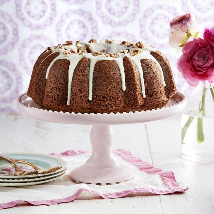 """<p>There's a dash of pumpkin pie spice in this carrot cake for an extra-flavorful bite.</p><p><strong><a href=""""https://www.countryliving.com/food-drinks/a27244418/carrot-cake-cream-cheese-drizzle-recipe/"""" rel=""""nofollow noopener"""" target=""""_blank"""" data-ylk=""""slk:Get the recipe"""" class=""""link rapid-noclick-resp"""">Get the recipe</a>.</strong></p><p><a class=""""link rapid-noclick-resp"""" href=""""https://www.amazon.com/Nordic-Ware-Cast-Original-Bundt/dp/B000HM9UDO/?tag=syn-yahoo-20&ascsubtag=%5Bartid%7C10050.g.3185%5Bsrc%7Cyahoo-us"""" rel=""""nofollow noopener"""" target=""""_blank"""" data-ylk=""""slk:SHOP BUNDT PANS"""">SHOP BUNDT PANS</a><br></p>"""