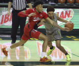Baylor guard MaCio Teague (31) drives the ball against Texas Tech guard Terrence Shannon Jr. (1) in the second half of an NCAA college basketball game Sunday, March 7, 2021, in Waco, Texas. (AP Photo/Jerry Larson)