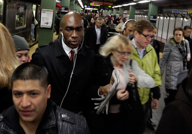"""In this photo taken March 14, 2013, morning commuters fill the platform as they exit a train in New York's Times Square subway station. An historic decline in the number of U.S. whites and the fast growth of Latinos are blurring traditional black-white color lines, testing the limits of civil rights laws and reshaping political alliances as """"whiteness"""" begins to lose its numerical dominance. The demographic shift is now a potent backdrop to an immigration overhaul bill being debated in Congress that could offer a path to citizenship for 11 million mostly Hispanic illegal immigrants.  (AP Photo/Richard Drew)"""