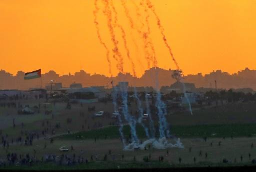 Tear gas rises amidst Palestinian protesters during clashes along the Gaza border in this picture taken from the Israeli side of the frontier on May 15, 2018