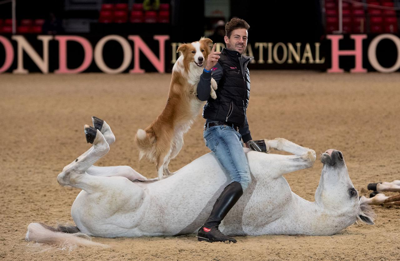 </p> <p>Spanish equestrian artist Santi Serra sits on his horse Kyfruc with his dog Banch ahead of the Olympia The London International Horse Show on Dec. 12, 2016, in West London, Britain. (Steve Parsons/PA Wire via ZUMA Press) </p> <p>