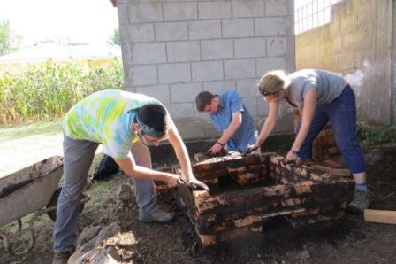 James, Tucker, and Rachel building the charcoal kiln.