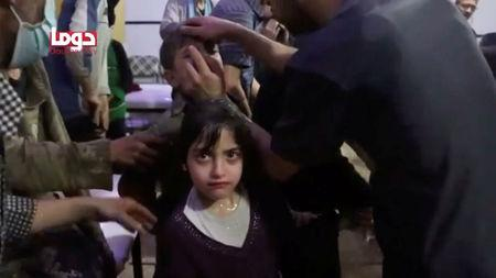 A girl looks on following alleged chemical weapons attack, in what is said to be Douma