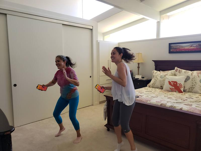 Kat Vasquez (right) is getting a Wii workout with her mom. (Photo: Kat Vasquez)