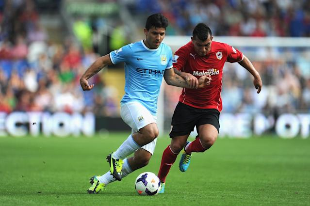 CARDIFF, WALES - AUGUST 25: Cardiff City player Gary Medel (r) battle for the ball with Sergio Aguero of Manchester City during the Barclays Premier League match between Cardiff City and Manchester City at Cardiff City Stadium on August 25, 2013 in Cardiff, Wales. (Photo by Stu Forster/Getty Images)