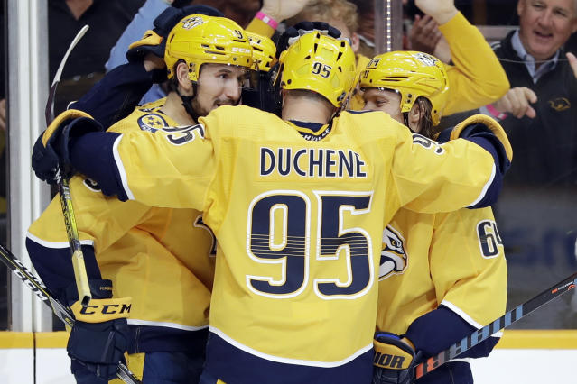 Nashville Predators left wing Filip Forsberg (9), of Sweden, is congratulated by Matt Duchene (95) and Mikael Granlund (64), of Finland, after scoring a goal against the Detroit Red Wings during the second period of an NHL hockey game Saturday, Oct. 5, 2019, in Nashville, Tenn. (AP Photo/Mark Humphrey)