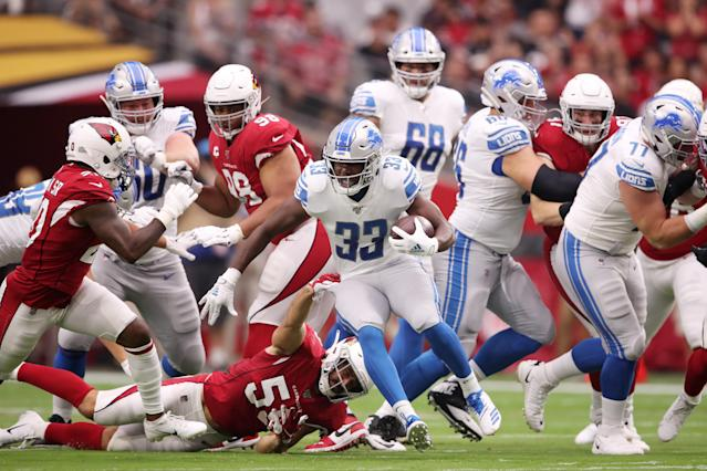 Running back Kerryon Johnson #33 of the Detroit Lions rushes against linebacker Joe Walker #59 of the Arizona Cardinals in the first quarter of the game at State Farm Stadium on September 08, 2019 in Glendale, Arizona. (Photo by Christian Petersen/Getty Images)