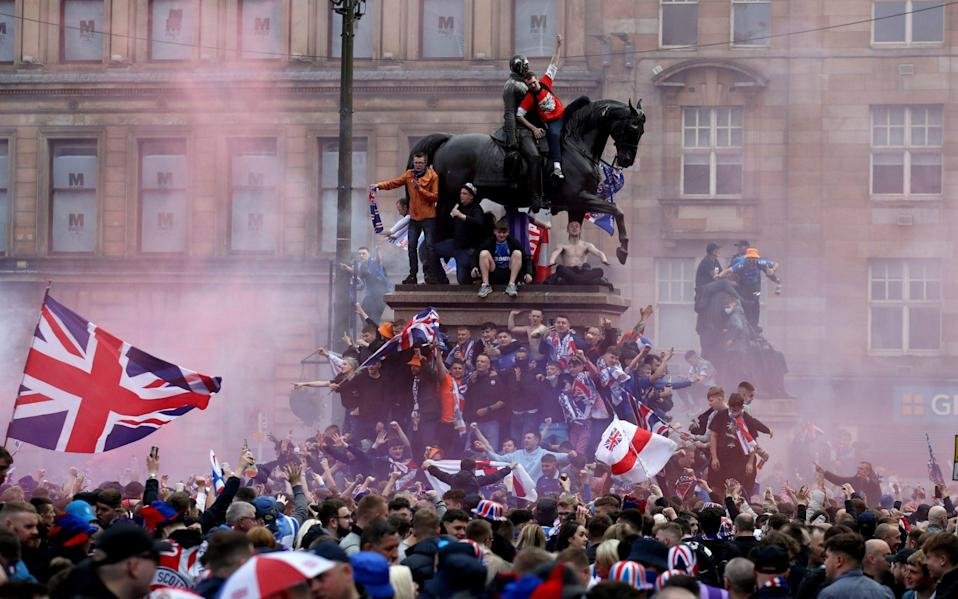 Rangers fans celebrate winning the Scottish Premiership in George Square on Saturday - PA