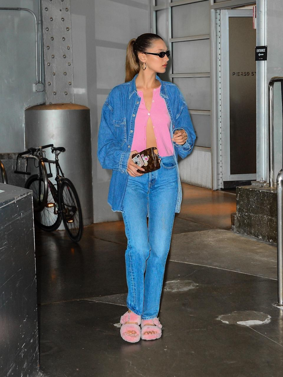 Bella Hadid in denim-on-denim and fuzzy slides