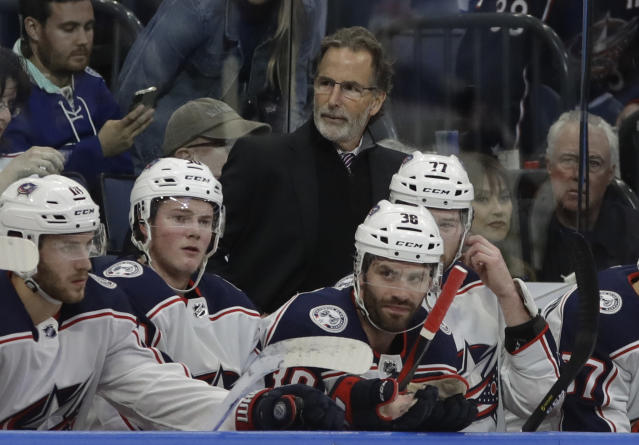 FILE - In this Jan. 8, 2019, file photo, Columbus Blue Jackets coach John Tortorella stands behind player during the first period of the team's NHL hockey game against the Tampa Bay Lightning in Tampa, Fla. Tortorella acknowledged hes carrying around a chip on his shoulder about the high-profile departures since last season and the predictions of doom. (AP Photo/Chris O'Meara, File)