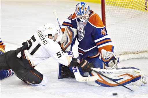 Anaheim Ducks Kyle Palmieri is stopped by Edmonton Oilers goalie Devan Dubnyk during third period NHL hockey action in Edmonton, Alberta Sunday April 21, 2013. (AP Photo/ The Canadian Press, Janson Franson)