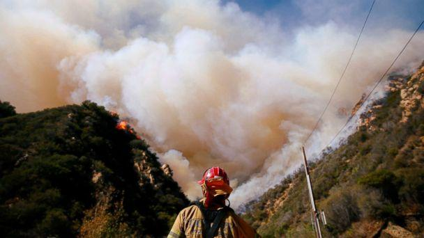 PHOTO: Firefighters battle the Woolsey Fire as it continues to burn in Malibu, Calif., Nov. 11, 2018. (Eric Thayer/Reuters)