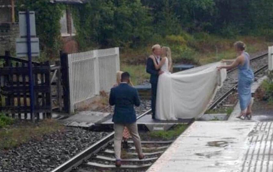 A couple kiss on a railway track near Whitby, North Yorkshire. (SWNS)