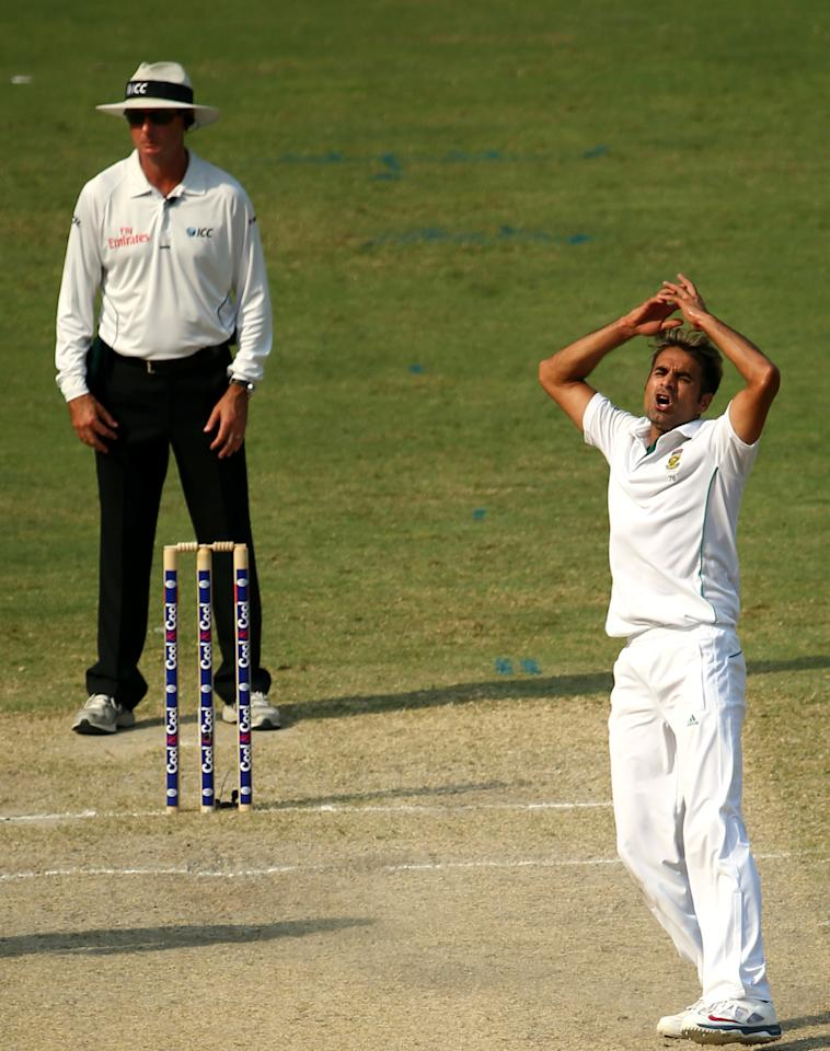 Pakistani bowler, Imran Tahir, of South Africa reacts during the third day of the second Test cricket match between Pakistan and South Africa in Dubai on October 25, 2013.      AFP PHOTO/ MARWAN NAAMANI        (Photo credit should read MARWAN NAAMANI/AFP/Getty Images)