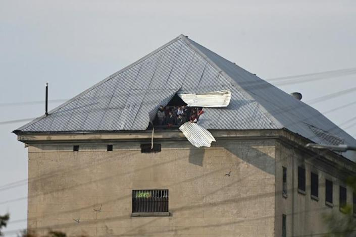 Inmates at Villa Devoto prison rioted and shouted their demands for better coronavirus protection on April 24 (AFP Photo/JUAN MABROMATA)