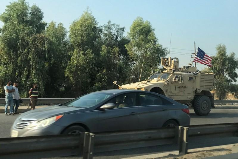 A U.S military vehicle is seen driving on a street in Dohuk