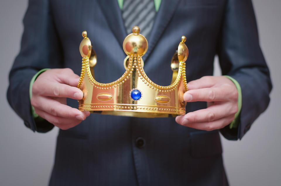 Businessman holding a crown