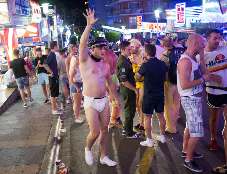 A young British tourist gestures in Punta Ballena street as he has fun in the Magalluf zone, in Calvia on Mallorca Island late on August 1, 2014 (AFP Photo/Jaime Reina)