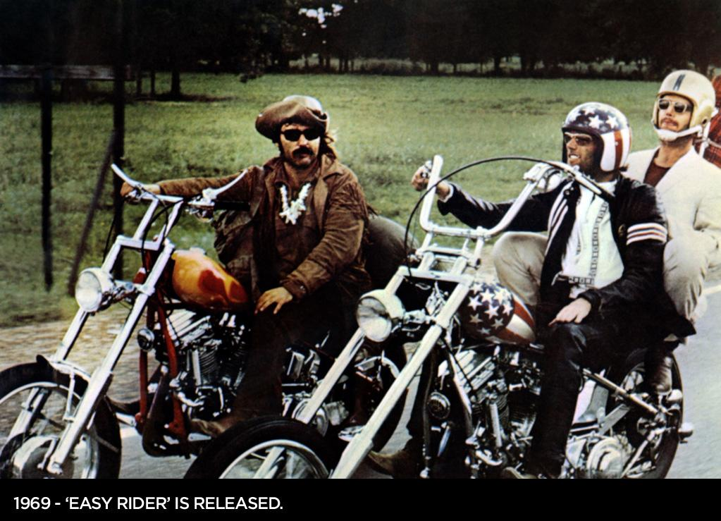 1969  Dennis Hopper's 'Easy Rider' premieres in New York. The hippie road trip movie follows Billy (Dennis Hopper) and Captain America (Peter Fonda) as they travel through the American southwest.