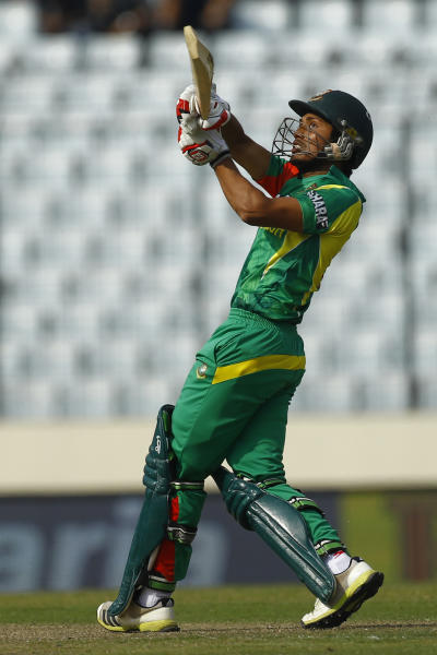 Bangladeshi cricket player Anamul Haque bats during the Asia Cup one-day international cricket tournament against Pakistan in Dhaka, Bangladesh, Tuesday, March 4, 2014. (AP Photo/A.M. Ahad)