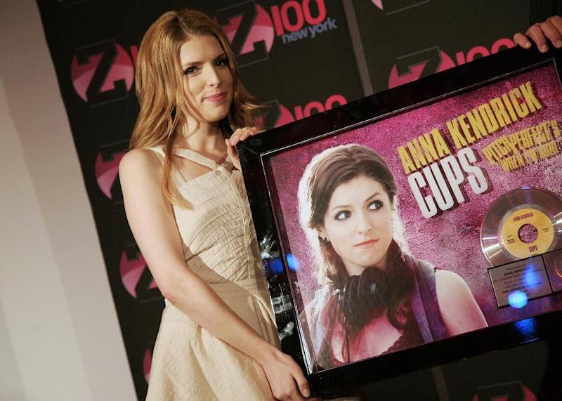 """FILE - This June 7, 2013 file photo shows actress Anna Kendrick at an appearance at the iHeartRadio Theater in New York. Since its release in Sept. 2012, """"Pitch Perfect: Original Motion Picture Soundtrack"""" has peaked at No. 3 on Billboard's 200 albums chart and has sold more than 700,000 units, according to Nielsen SoundScan. Kendrick's """"Cup"""" is certified platinum and is a Top 30 hit on the Billboard Hot 100 chart. (Photo by Andy Kropa/Invision/AP, file)"""