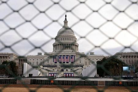 The U.S. Capitol building is seen behind a security fence in Washington, U.S., January 19, 2017. REUTERS/Shannon Stapleton