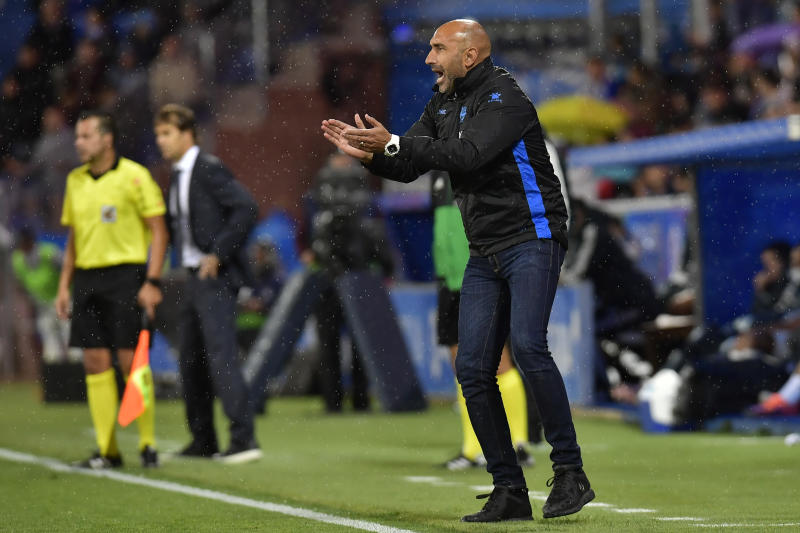 FILE - In this Saturday, Oct. 6, 2018 file photo, Deportivo Alaves' head manager Abelardo Fernandez, encourages his players during the Spanish La Liga soccer match between Real Madrid and Deportivo Alaves at Mendizorroza stadium, in Vitoria, northern Spain. The Spanish league only has four games remaining, but there are some coaches who may not make it that far. Real Betis manager Quique Setien and Girona's Eusebio Sacristan are under pressure after losing streaks, while Alaves coach Abelardo Fernandez has had a falling out with his club over his future. (AP Photo/Alvaro Barrientos, File)